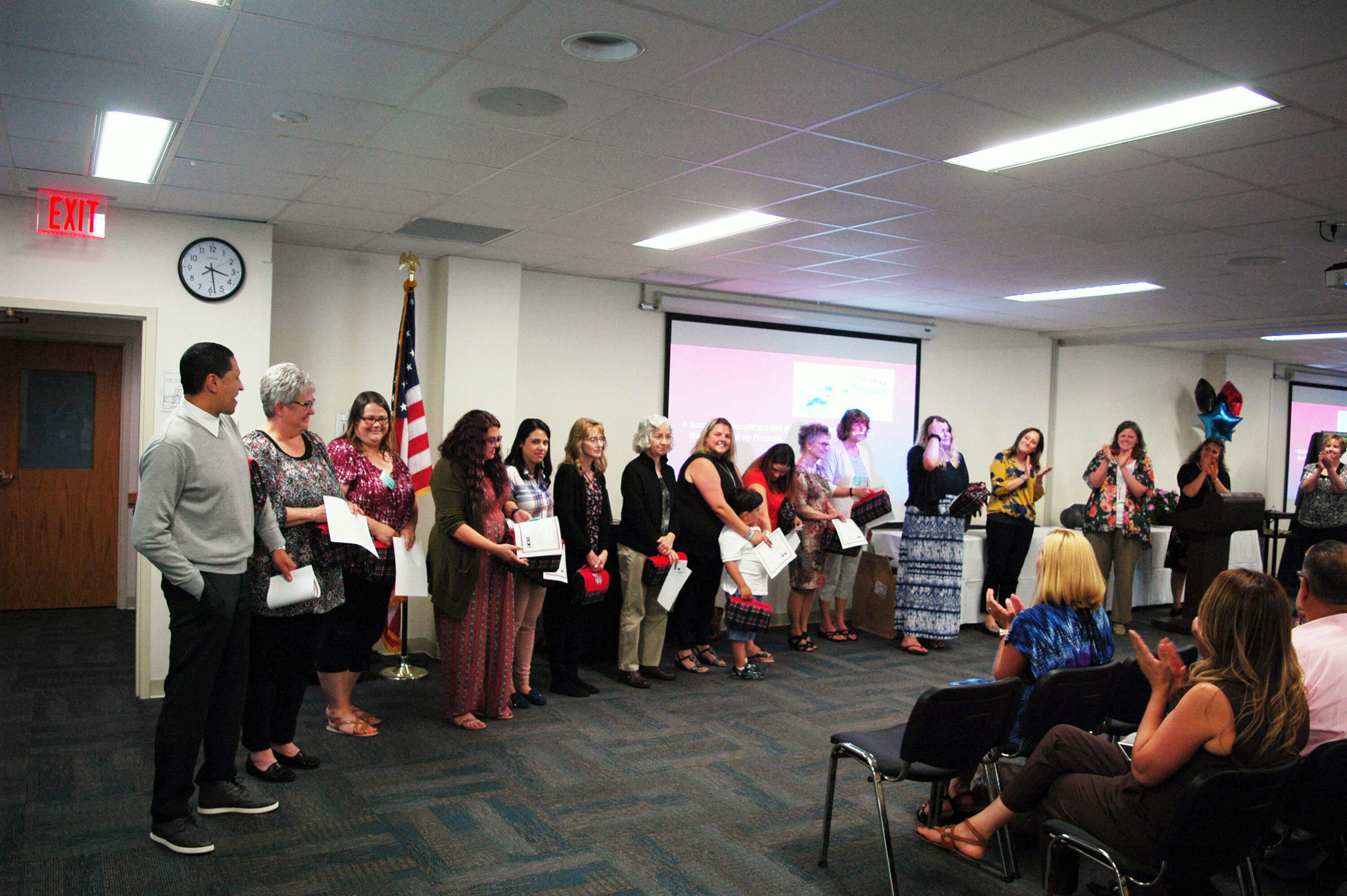 Wilson School District's 14 graduates accept the applause of their peers and families.