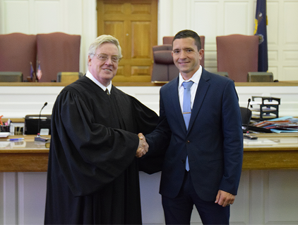 Mr. Christian Temchatin (right) is commissioned by President Judge Parisi as the new superintendent of the Kutztown Area School District